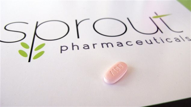 A tablet of flibanserin sits on a brochure for Sprout Pharmaceuticals. The Raleigh, North Carolina-based company is being bought by Canadian pharmaceutical company, Valeant, two days after winning Food and Drug Administration approval for flibanserin, dubbed Addyi, the first drug to boost women's sexual desire.