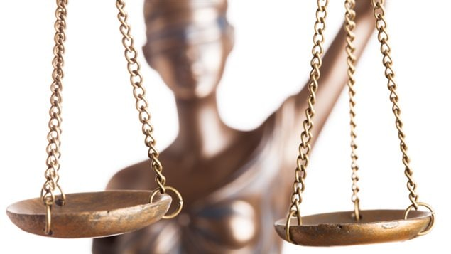 An image of lady justice holding balance scales.