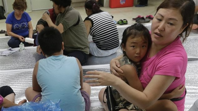 South Korean residents gather at a shelter in the South Korean town of Yeoncheon where an artillery shell fell Thursday.