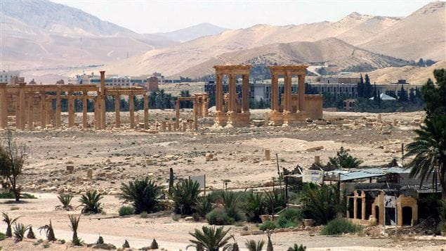 This file photo, released on May 17, 2015, by the Syrian official news agency SANA,, shows the general view of the ancient Roman city of Palmyra, northeast of Damascus, Syria. Activists say Islamic State militants have destroyed a temple at Syria's ancient ruins of Palmyra. News that the militants blew up the Baalshamin Temple came after the extremists beheaded Palmyra scholar Khaled al-Asaad on Tuesday, hanging his bloodied body from a pole in the town's main square