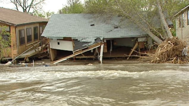 Powerful winds whipped across Lake Manitoba, creating large waves that pounded the shore and crashed into homes and cottages.