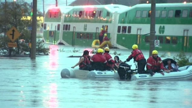 Passengers from a commuter train in Toronto had to be rescued as an abnormal amount of rain fell suddenly on Canada's biggest city. City cewers were unable to cope with the amount resulting in major flooding of streets, highways and the dity subway system.