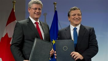 Canada's prime minister (left) signed an agreement in principle on trade with Europe in October 2013. If it is ratified it could be easier for provinces to trade with other countries rather than with each other.
