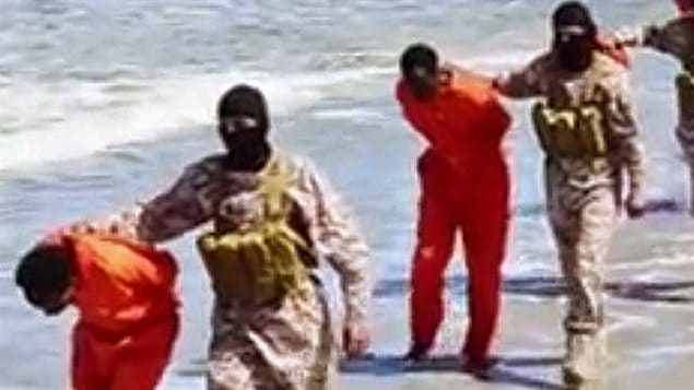 Screen shot of ISIS militants released in April parading Ehtiopian Christian prisoners later shot and beheaded in a mirror incident to one in February in which 21 Egyptian Christians were killed on a Libyan beachThe video also shows Islamic militants destroying churches, Christian cemetaries and icons.