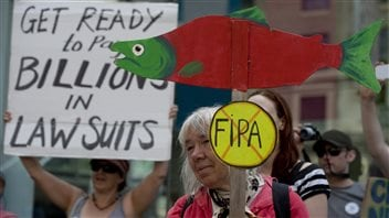 Citizens protest the Canada-China Foreign Investment Promotions and Protection Agreement in the western city of Vancouver on June 5, 2013.
