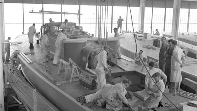 Workers on the deck of a motor torpedo boat, under construction in Montreal, Québec, Canada, 24 April 1941. Canada's role in the war was critical in the victory, providing all types of military hardware along with food, construction material, oil, medicine, clothing and valiant fighting forces.