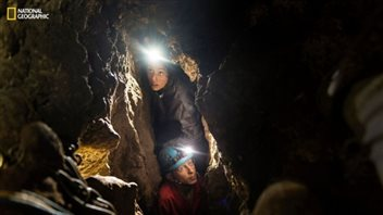 Researchers had to squeeze through narrow chutes leading to the cave containing the bones of the new species.