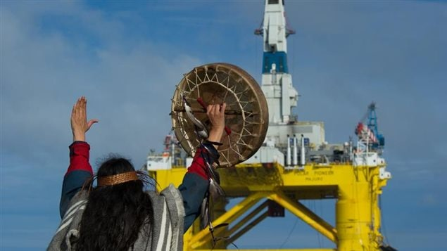 June 17,2015 Audrey Siegl, a Musqueam woman from British Columbia, Canada, who is also a renowned public speaker, drummer and singer, stands in a Greenpeace rhib launched from the MY Esperanza holding her arm out in front her, defiantly signaling Shell's subcontracted drilling rig, the Polar Pioneer, to stop