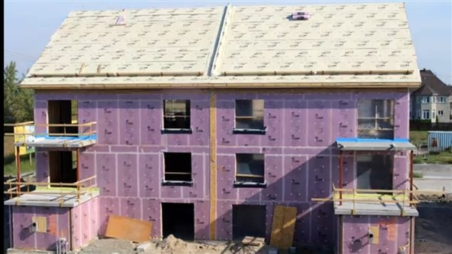 Recent image of the six-plex condo unit being built in Laval, north of montreal. Extra insulation and sealing can be seen on walls and roof.