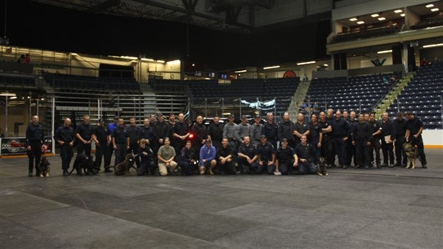 Group photo of handlers and dogs at the 2015 Canadian Police Canine Assoc trials in Medicine Hat, Alberta