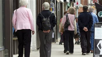 Senior citizens make their way down a street in Peterborough, Ontario in May, 2012.