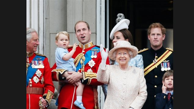 Queen Elizabeth II marks her ceremonial birthday during the Trooping the Colour parade at Buckingham Palace with Prince Charles, Prince Willian holding Prince George, Catherine, the Duchess of Cambridge and Prince Harry on June 13, 2015. The Queen became the longest serving British monarch this year, but there is no indication she would step aside in favour of Prince Charles, or that he would do the same in favour of the more popular Prince William
