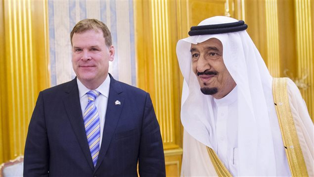 In this photos provided by the Saudi Press Agency, Crown Prince Salman bin Abdulaziz Al Saud, right, meets Canadian Minister of Foreign Affairs John Baird in his office in Jiddah, Saudi Arabia, Thursday, Oct. 16, 2014. The two discussed bilateral relations and regional and international events.