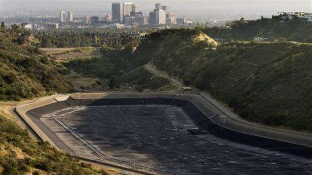 An empty water reservoir is seen in the hills above Los Angeles as a severe drought continues to affect the state of California on April 5, 2015