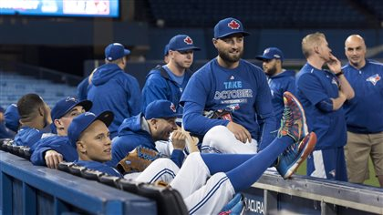Members of the Blue Jays gather before a team workout at the Rogers Centre in on Tuesday. Can the boys of summer keep it up in the fall? We see the boys dressed in blue sweat shirts with the words