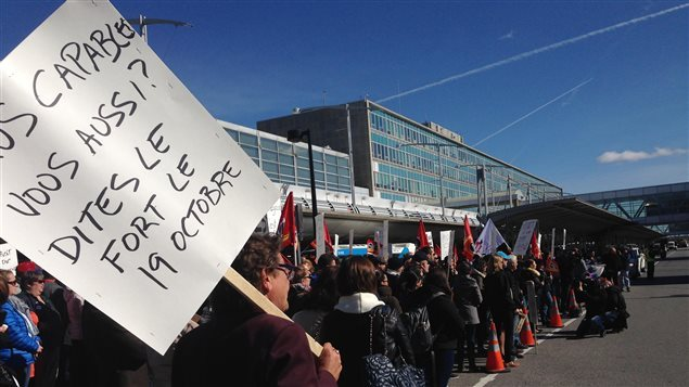 About 200 border security agents staged a peaceful surprise portest at Montreal's international airport today to protest budget cuts and job losses, and a threat to Canadian security