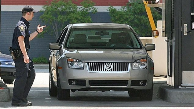CBSA agent waves a car over for secondary inspection at a US-Canada border crossing. Budget cuts starting in 2012 have meant a dwindling number of agents at entry points and for other inspections, cush aas ship and plane cargo