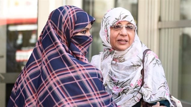 Zunera Ishaq (left) embraces her friend Nusrat Wahid after the Federal Court of Appeal agreed with a lower court and overturned the proposed government ban on the wearing of niqabs at citizenship ceremonies in September
