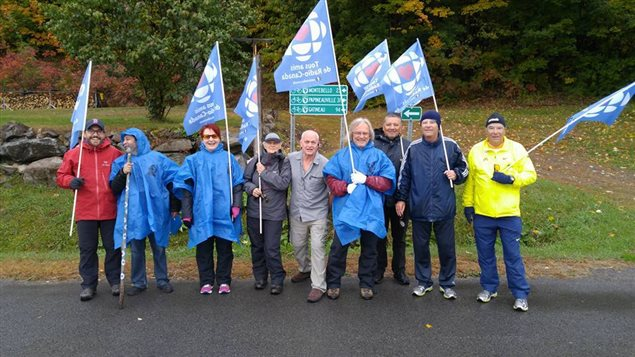 The group of marchers with a couple of local supporters along the way, shown on October 9. A little rain didn't slow the marchers who covered between 30 - 40km a day during the march to Ottawa