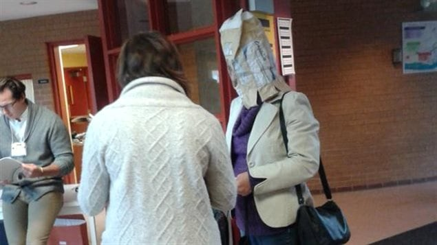 A woman in Cap Rouge Quebec showed up to vote with a potato bag covering her head