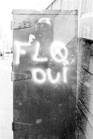 A postal box in Montreal bearing the graffiti FLQ oui (FLQ yes) in July 1971. The FLQ conducted several bombings of post boxes which typically bore a decal of the Royal Coat of Arms of Canada. It is not clear whether this was a leftover from earlier in the crisis, or the work of a lingering sympathizer after the end of the crisis.