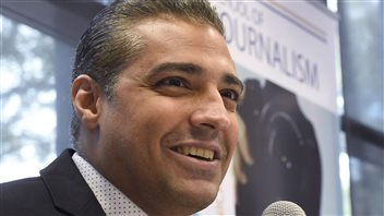 Mohamed Fahmy had strong words about the lack of support from the Harper government during his legal troubles in Egypt. We see a closeup of Fahmy behind a microphone. He is smiling as he answers a question at the Ryerson event.