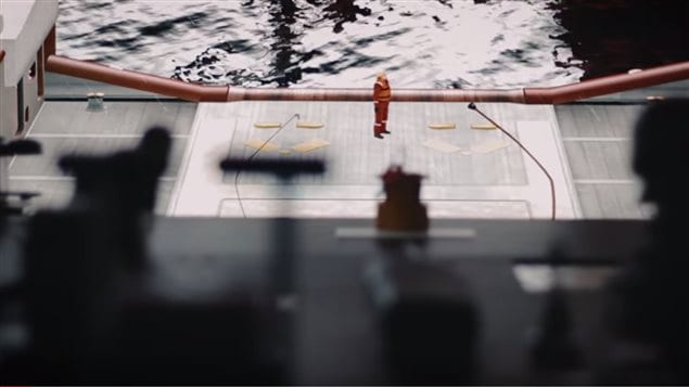 Another screen imitates a window toward the stern of ths ship showing a worker on deck. Endless varieties of situations and conditions can be programmed into the training scenarios