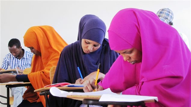 Students work on their York University courses in the Borderless Higher Education for Refugees learning centre in Dadaab camp in Kenya.