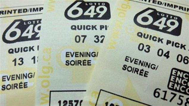 """A Mississauga ticket holder has won the largest lottery jackpot in Canadian history, which sits at $64 million. The winner has not yet come forward to claim the prize. We see three lotto tickets spread like a hand of cards. The Lotto 649 logo is printed at the top of the cards. Lower down on the cards, we see the words """"quick pick"""" and some numbers. Underneath the numbers, we see the words """"evening/soiree."""""""