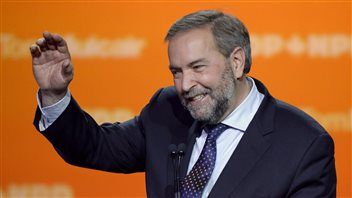NDP handlers may have made a mistake trying to get their tough leader Tom Mulcair to smile more.