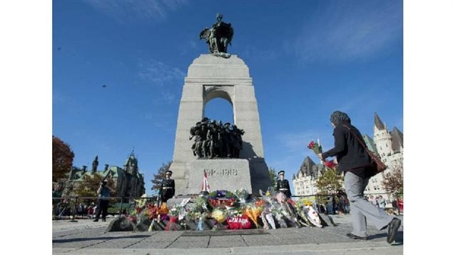 Oct 24, 2014: Citizens leave flowers at the National War Memorial and Tomb of the Unknown Soldier  two days after the murder of Cpl Cirillo, who was on Ceremonial Guard duty.