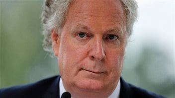 Jean Charest says he's perfectly happy to make his living as a lawyer at a prominent Montreal law firm and won't be returning to politics. We see a very tight closeup of Charest's face. The photo is cropped at the top of his forehead but his hair does appear slightly whiter than in the photo at the top. Her wears a slightly chagrined expression.