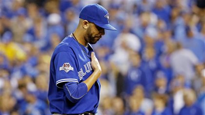 David Price departs in the seventh inning on Friday. Was he tipping his pitches? Prince has his right hand over his heart and his head looking down. His uniform and hat match his mood: blue.