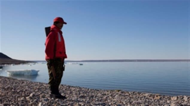 Canadian Ranger Moses Kigusiutnak of Arviat, Nunavut, looks out at a bay near Resolute, Nunavut. The Canadian Forces ombudsman is launching a full review of the Canadian Ranger program. The Rangers are often referred to as Canada's