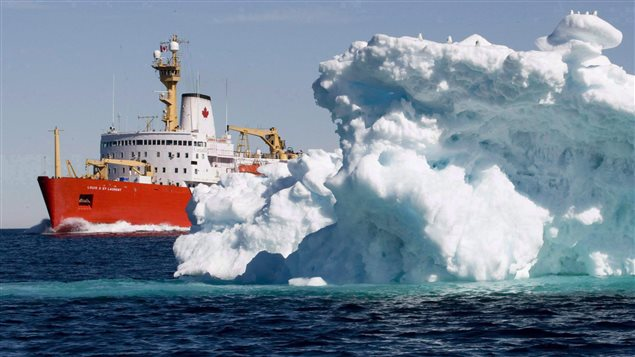 The Canadian Coast Guard icebreaker Louis S. St-Laurent sails past a iceberg in Lancaster Sound, Friday, July 11, 2008.