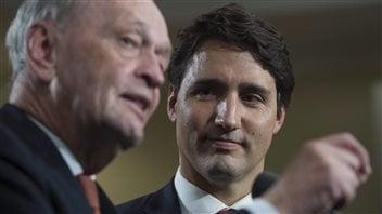 Liberal Leader Justin Trudeau and former prime minister Jean Chretien speak to the media in Hamilton, Ont., on September 13, 2015.