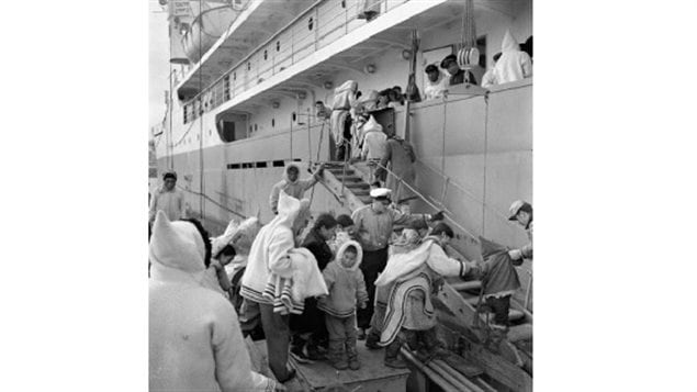 Inuit board the C.D. Howe for medical and eye check-ups Kimmirut (formerly Lake Harbour), Nunavut, 1951. Throughout the 1950s and 60s the ship made summer medical trips to the Eastern Arctic. If TB was found, the individual was kept on baord and not allowed to go ashore to collect belongings or say goodbye, before sailing south for treatment which could take 2-3 years. Some never returned, In 1956, one seventh of entire Inuit population was being treated in southern Canada.