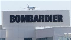 A plane comes in for a landing at a Bombardier plant in Montreal, Thursday, May 14, 2015.