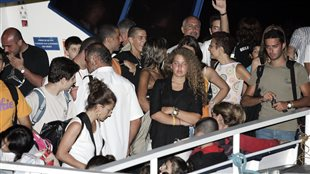 Canadians who where evacuated from Lebanon on the ferry Akgunler 1 wait to disembark in Mersin, Turkey Sunday, July 23, 2006.