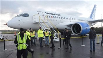 Bombardier's CSeries commercial jet sits on the tarmac prior to its first flight on Monday, Sept. 16, 2013 in Montreal. Bombardier is expected to report weak quarterly results this morning that will likely be overshadowed by the announcement of a government bailout of its troubled CSeries commercial jet project.