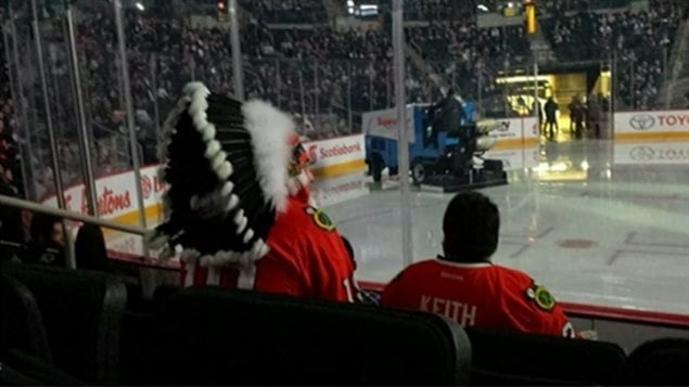 A fan wore an aboriginal headdress at a hockey game last March between the Winnipeg Jets and the Chicago Blackhawks. The Blackhawks' team logo is the head of an aboriginal man.