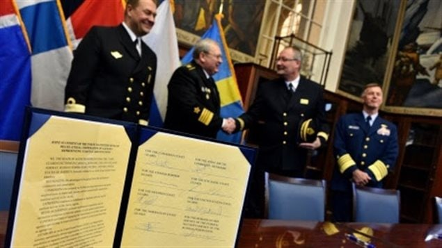 The Joint Statement officially establishing the Arctic Coast Guard Forum is displayed after being signed at the Coast Guard Academy in New London, Conn., Oct. 30, 2015. The Arctic Coast Guard Forum is an operationally-focused, consensus-based organization with the purpose of leveraging collective resources to foster safe, secure and environmentally responsible maritime activity in the Arctic. Membership includes Canada, Denmark, Finland, Iceland, Norway, Sweden, the Russian Federation and the United States. (U.S. Coast Guard photo by Petty Officer 2nd Class Patrick Kelley)