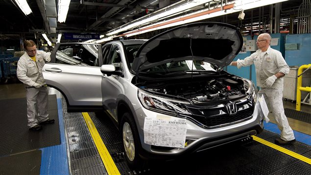 Workers inspect vehicles and work on the assembly line at Honda of Canada Mfg. Plant 2 in Alliston, Ont., on Monday, March 30, 2015. THE CANADIAN PRESS/Nathan Denette
