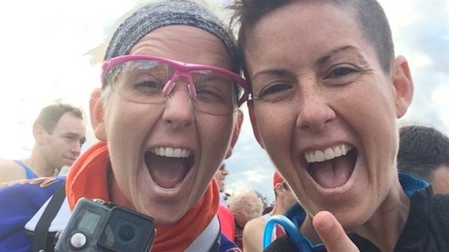 Kat Clewley (right), who lives in Burlington, Ont., ran Sunday's Road2Hope Hamilton Marathon backwards. Her official time was 4:48:42, which qualifies her to hold the first Guinness World Record.