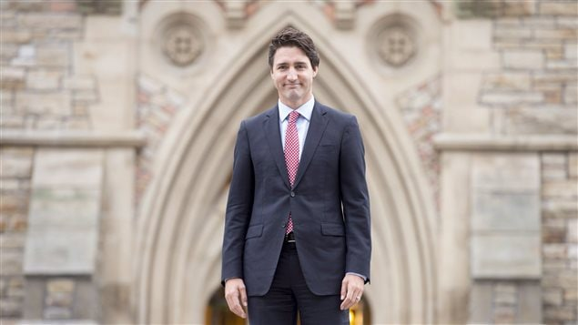 Prime minister-designate Justin Trudeau walks to a news conference from Parliament Hill in Ottawa on Oct. 20, 2015.