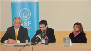 Pascal Paradis (centre), executive director of Lawyers Without Borders Canada, speaks at a press conference in Montreal Nov. 3, 2015. Sitting next to him is Ensaf Haidar, the wife of jailed Saudi blogger Raif Badawi, and Marc Sauvé of Quebec Bar Association.