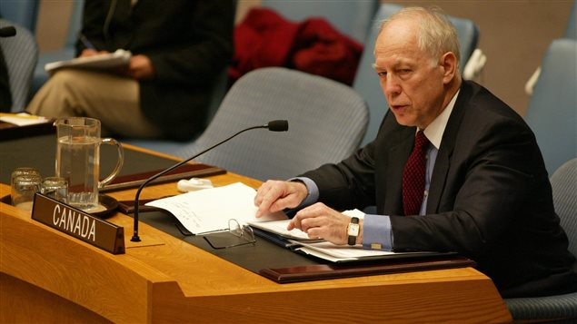 Canada's U.N. Ambassador Paul Heinbecker addresses the Security Council regarding Iraq Tuesday, March 11, 2003.
