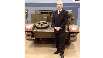 Brent Wilson, military history professor, University of New Brunswick. pictured here in front of a 1942Canadian designed and built Universal Carrier, also known as a Bren Gun carrier at an event he helped organize for Remembrance Day 2015