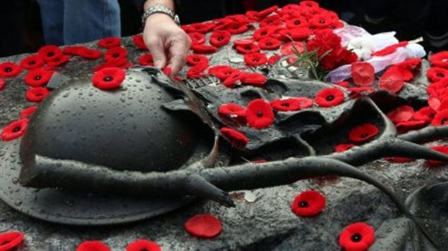 People have created a spontaneous tradition of placing their poppies on the Tomb of the Unknown soldier at the base of the National War Memorial following Remembrance ceremonies in Ottawa, the national capital.