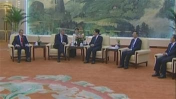 Former Prime Minister Stephen Harper (second from left) raised the case of Huseyin Celil with Chinese officials in Beijing in July 2014, but the Chinese refused to recognize Celil's Canadian citizenship.
